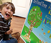 A child plays with the Food Tree Magnetic Board